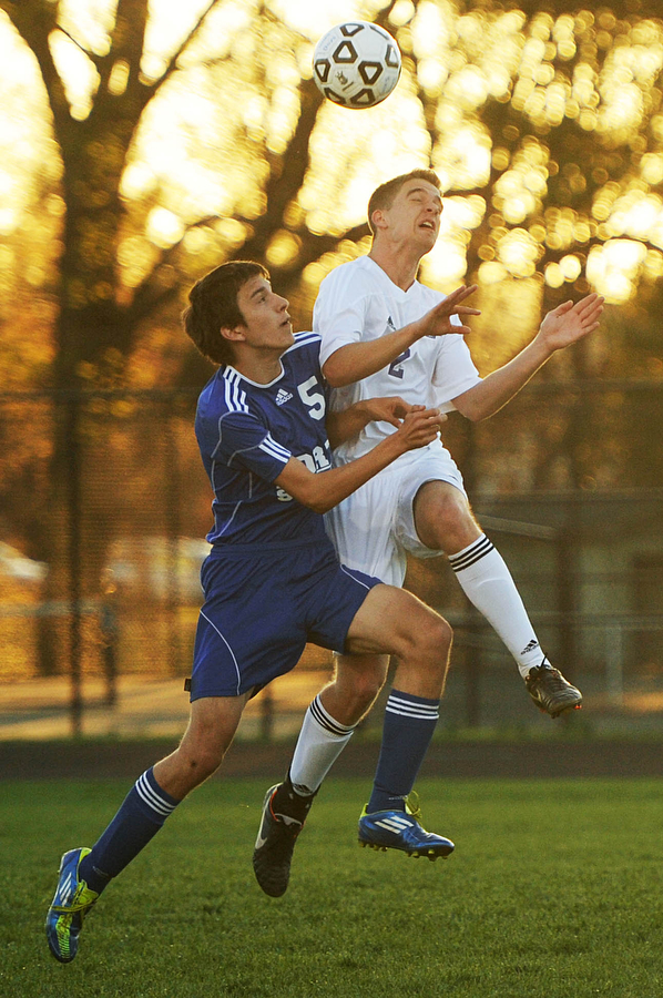 Fort Defiance's Ian Thibodeaux and Waynesboro's Eric Chandler go up to head butt the ball during the soccer game on Friday, April 12, 2013, in Waynesboro.
