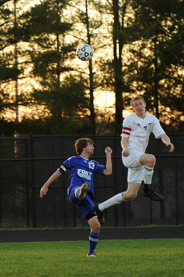 Fort Defiance's Todd Breeden and Waynesboro's Matt Farrington both go up for a head butt during the soccer game on Friday, April 12, 2013, in Waynesboro.