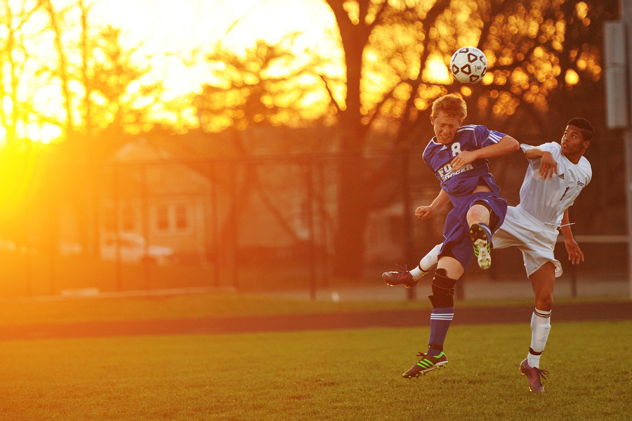 Fort Defiance's Braden Herman and Waynesboro's Denny Jimenez both go up for a head butt during the soccer game on Friday, April 12, 2013, in Waynesboro.