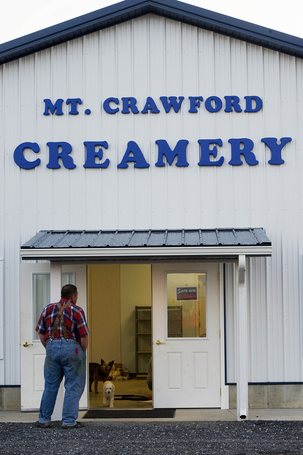 "Kenny Will stands outside of the store portion of Mt. Crawford Creamery at the end of the working day on Tuesday, April 16, 2013, in Mt. Crawford. The creamery has been in the process of opening for three years, and the Will brothers hope to open by the end of April or early May. ""The biggest challenge in all of this, there's no where you can go and get plannings or talk to someone to tell you what you need and this is how you do it,"" Frank Will said. ""You're kind of going blind on it. You're just kind of feeling your way in the dark. We basically came up with this design by ourselves."""