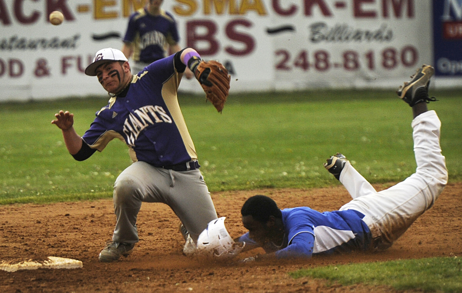 Waynesboro's Seth Knight attempts to tag out Lee's Xavier Lassiter at second base during the baseball game on Tuesday, April 30, 2013, in Staunton.