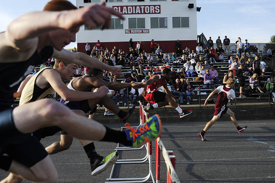 Competitors clear the hurdles during the final heat of the 110 meter hurdles during the Augusta County Invitational track meet on Friday, April 26, 2013 at Riverheads High School.