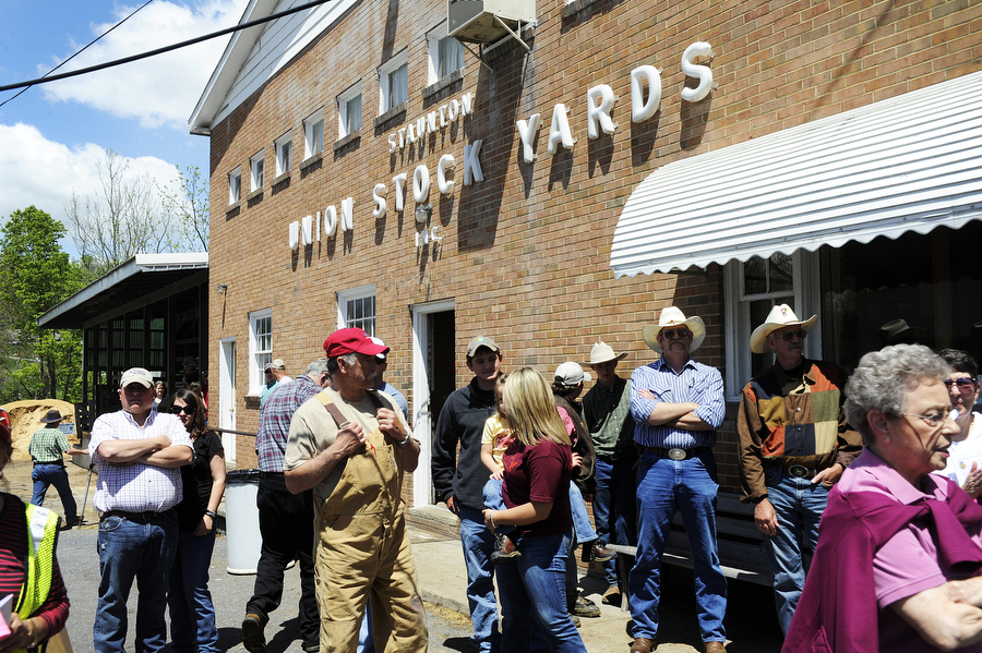 People mill about in front of the Union Stock Yards to watch people show their lambs during the Augusta County 4-H and FFA Market Animal Show and Sale on Wednesday, May 1, 2013, in Staunton. This year, the show featured more animals than ever before, even though there were less steers to be shown.