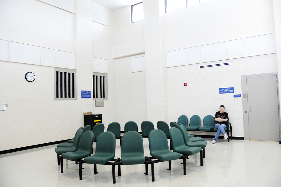 A girl sits in the waiting room before visitation at Middle River Correctional Jail on Friday, May 3, 2013, in Staunton. The jail has two visitation periods a day, and inmates are allowed one visitor for 15-30 minutes per week, pending behavior.