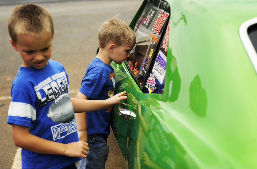 Blaine, 6, and Kalen Keys, 4, of Grottoes look at their dad's car before he competed in time trials at the Eastside Speedway on Sunday, June 2, 2013, in Dooms. The drag races involved street cars, footbrake, super pro, motorcycles and dragsters.