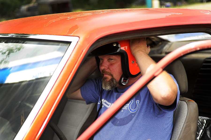 Greg Cash of Stuarts Draft puts in his helmet before competing during a drag racing event at Eastside Speedway on Sunday, June 2, 2013, in Dooms. The drag races involved street cars, footbrake, super pro, motorcycles and dragsters.