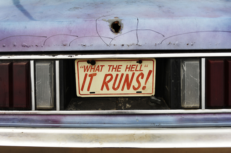 "A license plate reads ""What the hell, it runs!' on a car during a drag racing event at Eastside Speedway on Sunday, June 2, 2013, in Dooms. The drag races involved street cars, footbrake, super pro, motorcycles and dragsters."