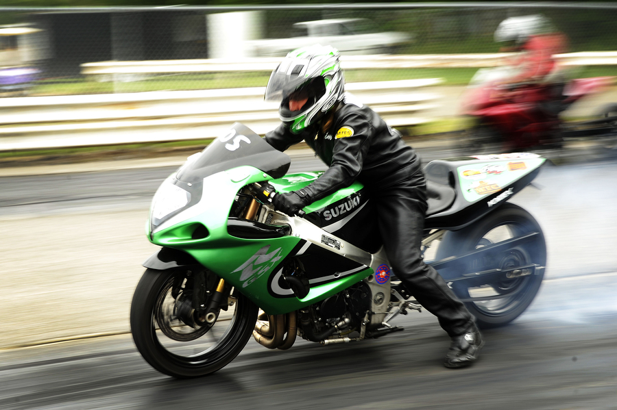 Motorcycle riders compete in time trials at the Eastside Speedway on Sunday, June 2, 2013, in Dooms. The drag races involved street cars, footbrake, super pro, motorcycles and dragsters.