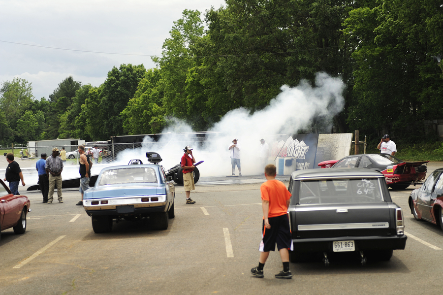 Drivers wait for their turn on the track as others burn rubber during a drag racing event at Eastside Speedway on Sunday, June 2, 2013, in Dooms. The drag races involved street cars, footbrake, super pro, motorcycles and dragsters.