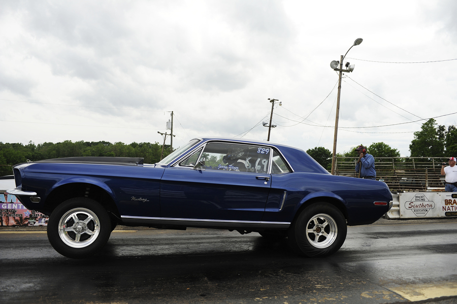 Footbrake cars compete during a drag racing event at Eastside Speedway on Sunday, June 2, 2013, in Dooms. The drag races involved street cars, footbrake, super pro, motorcycles and dragsters.