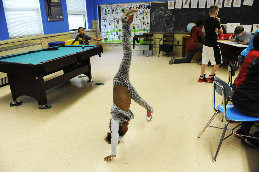 Toni Hurdle, 5, performs cartwheels in the game room the Boys and Girls Club on Thursday, June 6, 2013, in Staunton. The Boys and Girls Club will be starting a fundraiser to raise money for a new van to take the kids on trips.