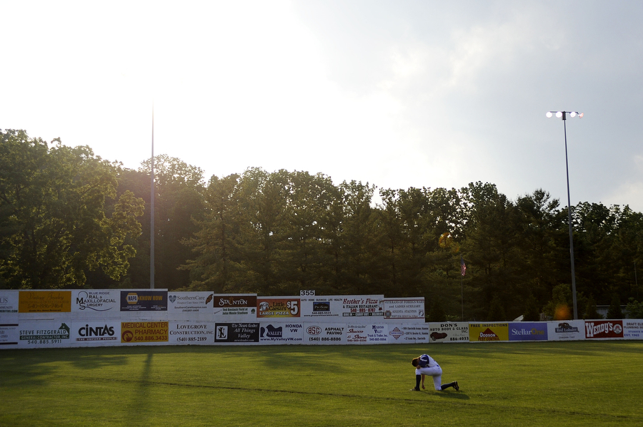 Braves' Ben Verlander kneels down for a moment to himself in the outfield before the game against the Harrisonburg Turks on Wednesday, June 6, 2013, in Staunton.