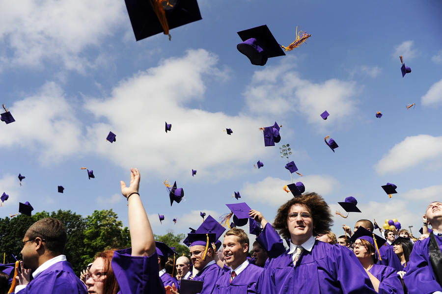 Graduates throw their hats in the air after graduating during the Waynesboro High School commencement ceremony on Saturday, June 8, 2013, in Waynesboro.
