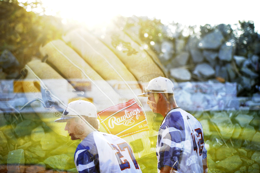 Double exposure frame with a baseball mitt layered over a frame of Braves' Zach Mawson and Dylan Caruso before the baseball game against Winchester on Tuesday, June 26, 2013, in Staunton.