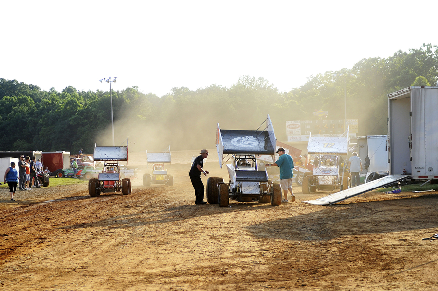 Sprint cars return to the pit after a qualifying race at Natural Bridge Speedway on Saturday, June 29, 2013, in Natural Bridge. NASCAR driver Jason Leffler was killed in a crash on June 12 at a dirt track in New Jersey, caused by a mechanical failure with the torsion bar on his car coming apart. The moose plug is expected to prevent that from happening.
