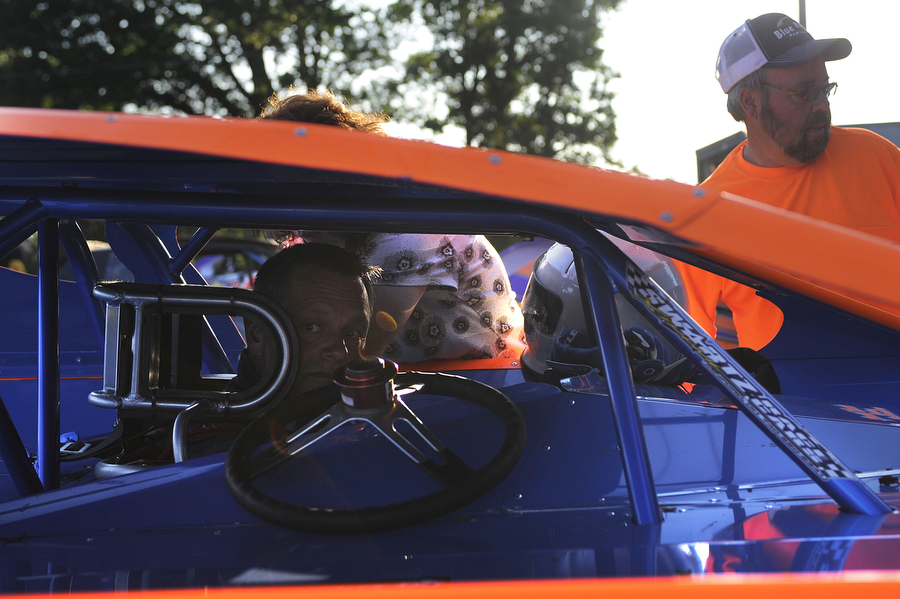 Driver Buck Roadcap gets inside his vehicle as car owner Kenny Tanner and wife Beth Roadcap get him ready for racing in the late model division during the dirt track races at Eastside Speedway on Friday, June 21, 2013, in Waynesboro. Roadcap races against nephew Derrick Rankin.
