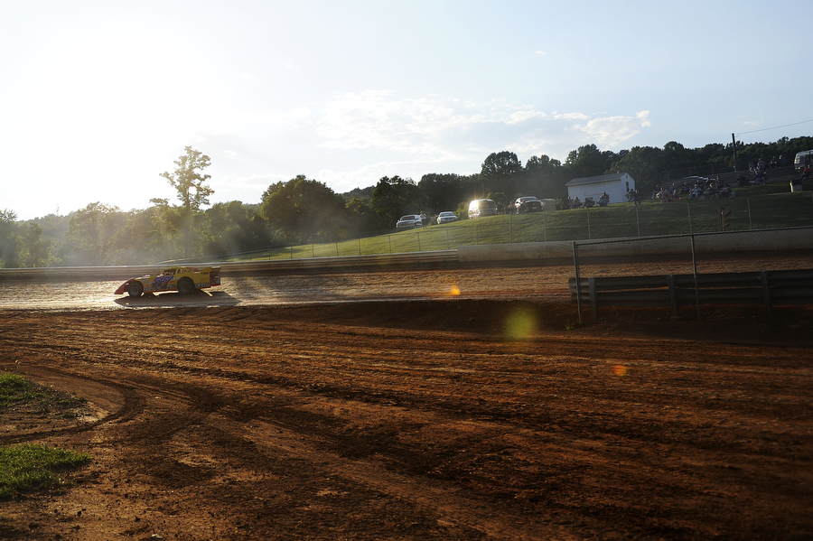Randy Gardner races in the sportsman division on the dirt track at Natural Bridge Speedway on Saturday, June 29, 2013, in Natural Bridge. The track is lined by two-pronged metal fencing, roughly four-feet high, along the straight-away portions of the course, and there is no fencing on the outside of the track along the curves at Natural Bridge. Natural Bridge also has a concrete wall on the inside straight-away.