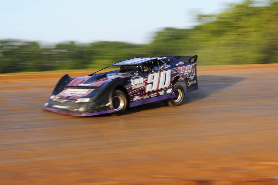 "Larry Ramsey races in the late model division on the dirt track at Natural Bridge Speedway on Saturday, June 29, 2013, in Natural Bridge. The track is lined by two-pronged metal fencing, roughly four-feet high, along the straight-away portions of the course, and there is no fencing on the outside of the track along the curves at Natural Bridge. ""The straight-aways are fine to keep the fans safe, but the turns for us, it's better not to have them [the fencing] at all,"" Bob Reiner said."