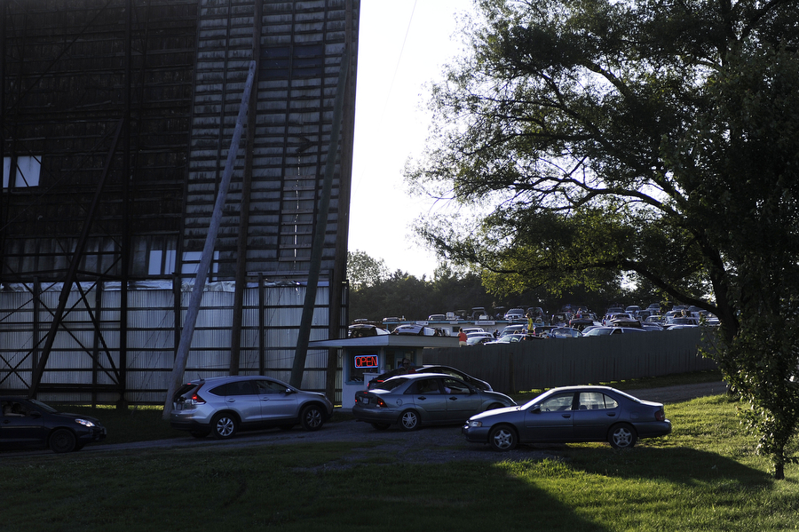 Cars wait in line to get tickets at Hull's Drive-In Theatre on Saturday, July 6, 2013, in Lexington. Hull's manager Jeremy Reter says many families find the ticket prices a good value, since prices are for a double feature. Adults pay $7 for two movies, and children cost $3.