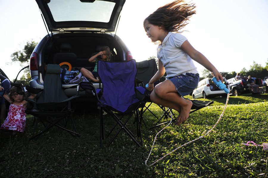 Ellie Palumbo, 6, of Waynesboro jumps rope while waiting for the movie to start at Hull's Drive-In Theatre on Saturday, July 6, 2013, in Lexington. The gates at the theater open at 6, but the show doesn't start until 9, so families often bring dinner, games and toys to keep their children entertained until it gets dark.