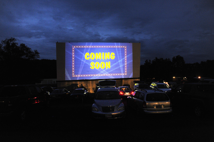 Previews get ready to run on the big screen at Hull's Drive-In Theatre on Sunday, July 7, 2013, in Lexington. The theater runs vintage concession ads and movie countdown clips during intermission, adding to the nostalgic feel of the drive-in.