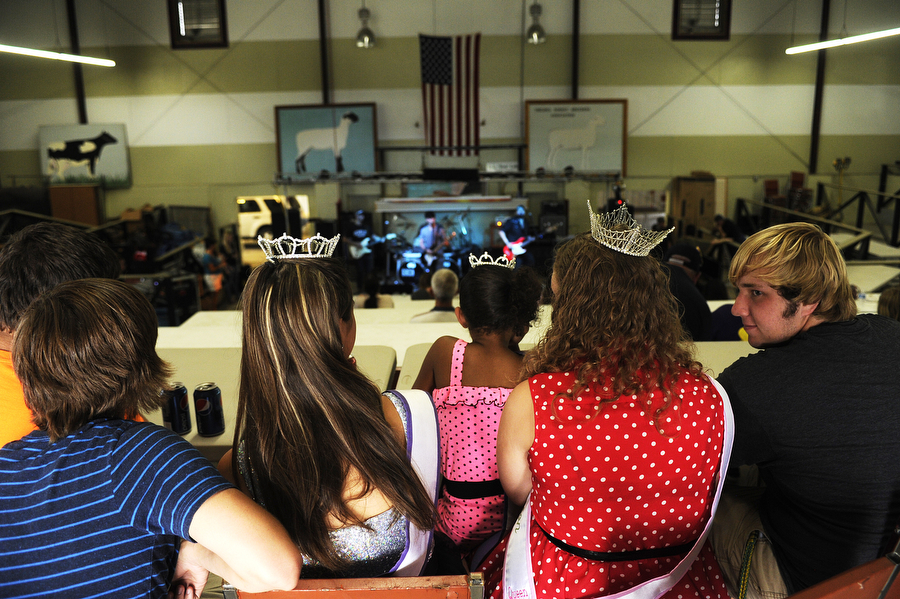 Pageant winners Alicia Lowry, Gigi Thomas and Reilly Shiflett watch a live band during a benefit for Raygan Batton on Sunday, July 14, 2013, at Expoland in Fishersville. The festival, which was to raise money for Raygan's medical treatment for cancer, featured a variety of fundraising options, such as cake walks, auctions, moon bounces and live music.