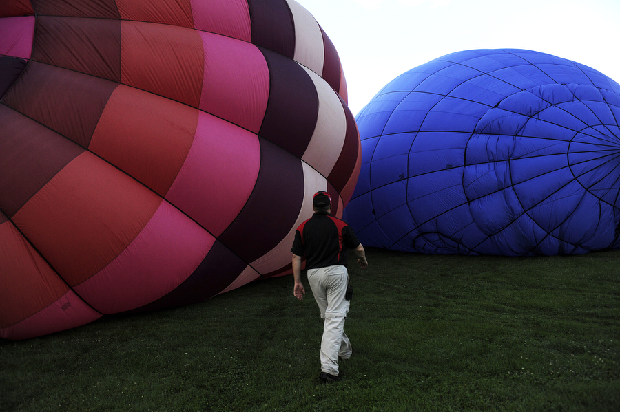 Pilot Wayne Fortney walks around his balloon, Rosie, as he readies it for a ride during Lexington's 17th Annual Balloon Rally on Friday, July 5, 2013, on the parade grounds at the Virginia Military Institute. The balloon launches continue in the early morning on July 6.