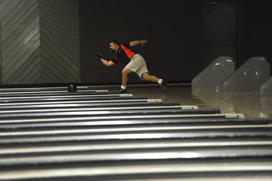 Tim Earhart sends his bowling ball down the lane during league night on Thursday, August 1, 2013 at Staunton Lanes.
