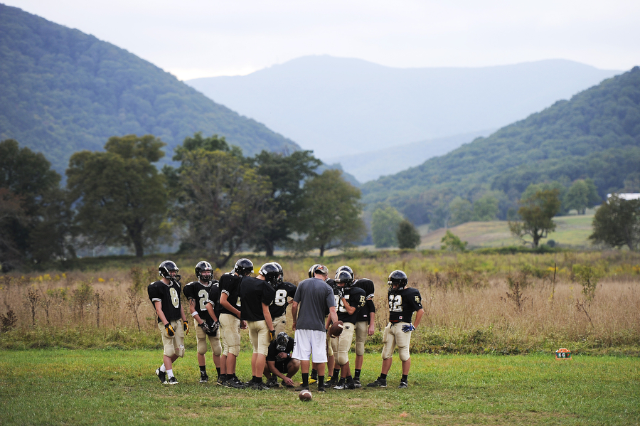 Buffalo Gap football players meet in a huddle during practice on Wednesday, Sept. 25, 2013, in Swoope. The players were preparing for a game against Riverheads on Friday night.