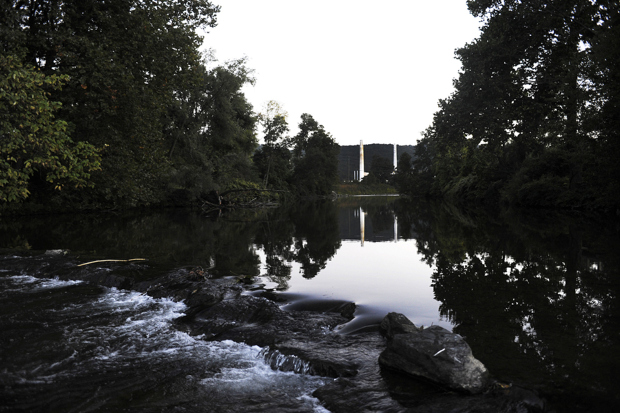 The Invista plant, formerly owned by DuPont, can be seen from the South River on Tuesday, Sept. 25, 2013, in Waynesboro. DuPont polluted the river sometime between the 1960s and 1970s with mercury, which was used as a catalyst in the manufacturing of a rayon fabric. DuPont has since taken responsibility for the pollution of mercury, and developed the South River Science Team with a number of other environmental and health agencies to monitor and clean up the river.