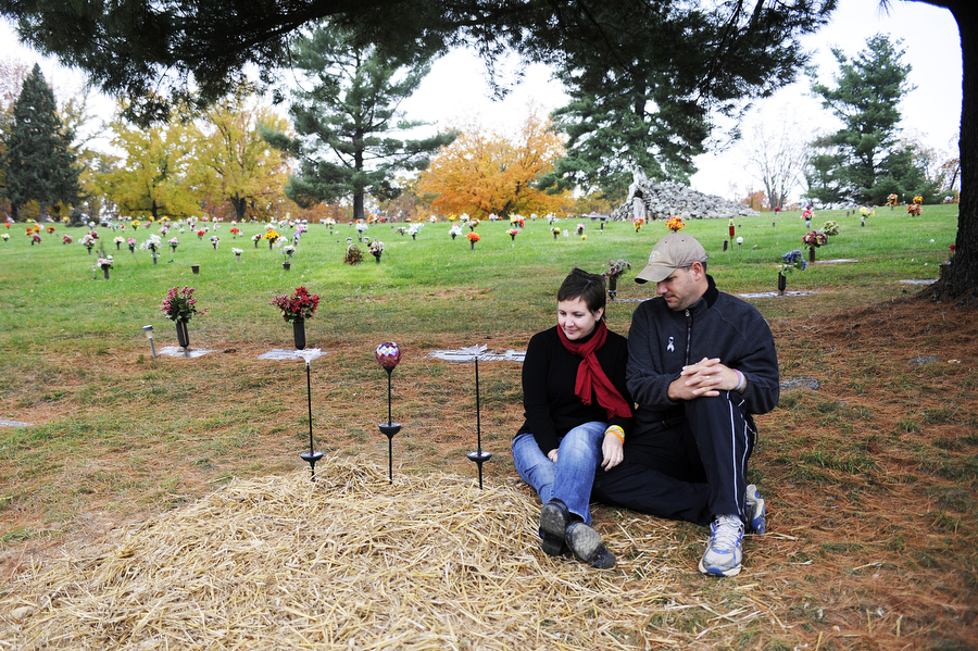 "Colleen and John visit Norah's grave Oct. 31. ""We keep visiting her,"" said her mom. ""Even though it's not her, she's in heaven — that's the closest that we can get to her that I know of."""