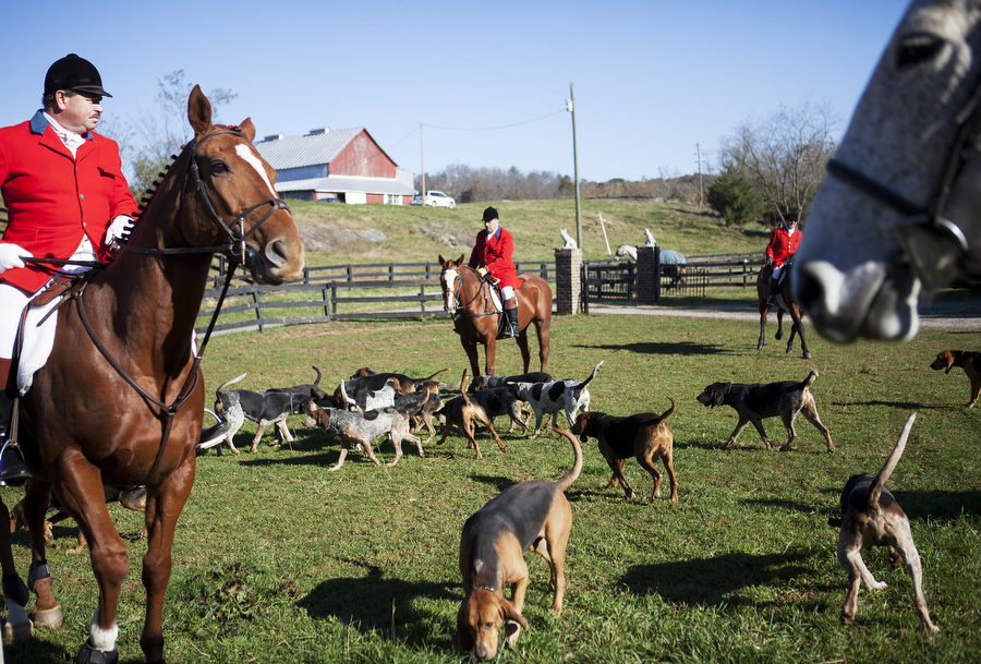 Hunters gather for the before the opening hunt with the Middlebrook Hunt Club on Saturday, Oct. 26, 2013, in Middlebrook.