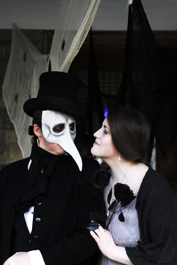 Joy Walker and Jennifer Southerington, dressed as an undertaker and Lenore for an Edgar Allen Poe poem, prepare the porch for trick-or-treaters on Thursday, Oct. 31, 2013, in Staunton. The house has been elaborately decorated for Halloween for the last four years under various themes, this year's being Edgar Allen Poe.