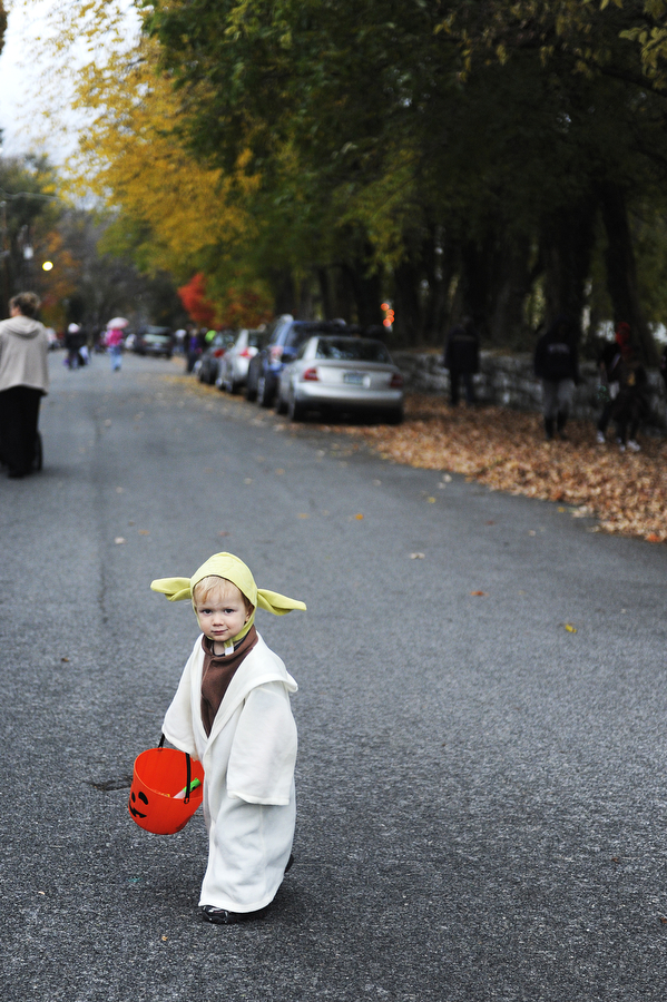 Hamish Kennedy, 2, waits to trick-or-treat more dressed as Yoda in the Sherwood neighborhood during Halloween on Thursday, Oct. 31, 2013, in Staunton.