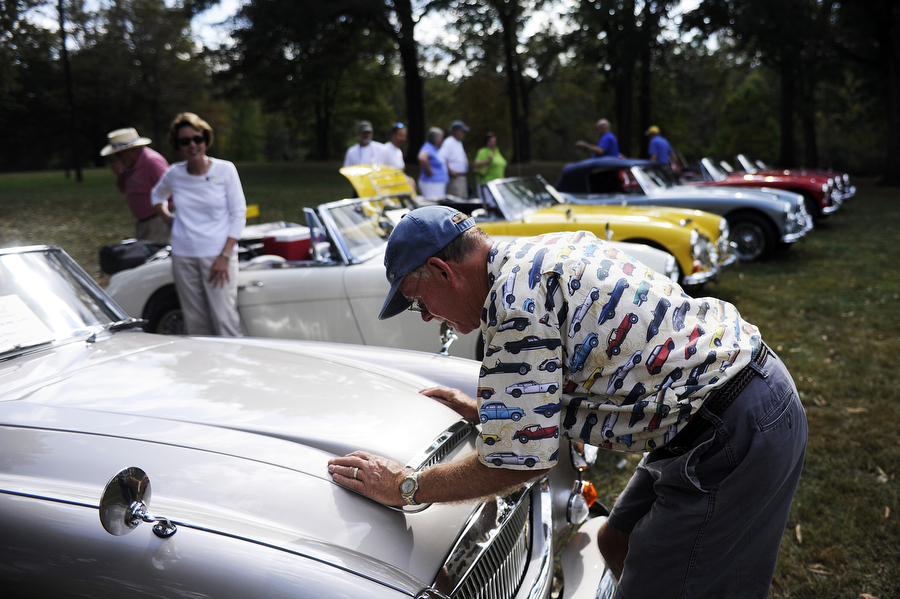 Jeff Rakes of Vinton packs up his 1967 Austin Healy during the British Car Show on Saturday, Oct. 5, 2013, at Ridgeview Park in Waynesboro.