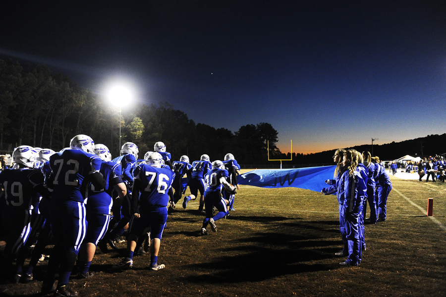 Fort Defiance football players run onto the field at the beginning of the football game against Waynesboro on Friday, Oct. 25, 2013, at Fort Defiance.