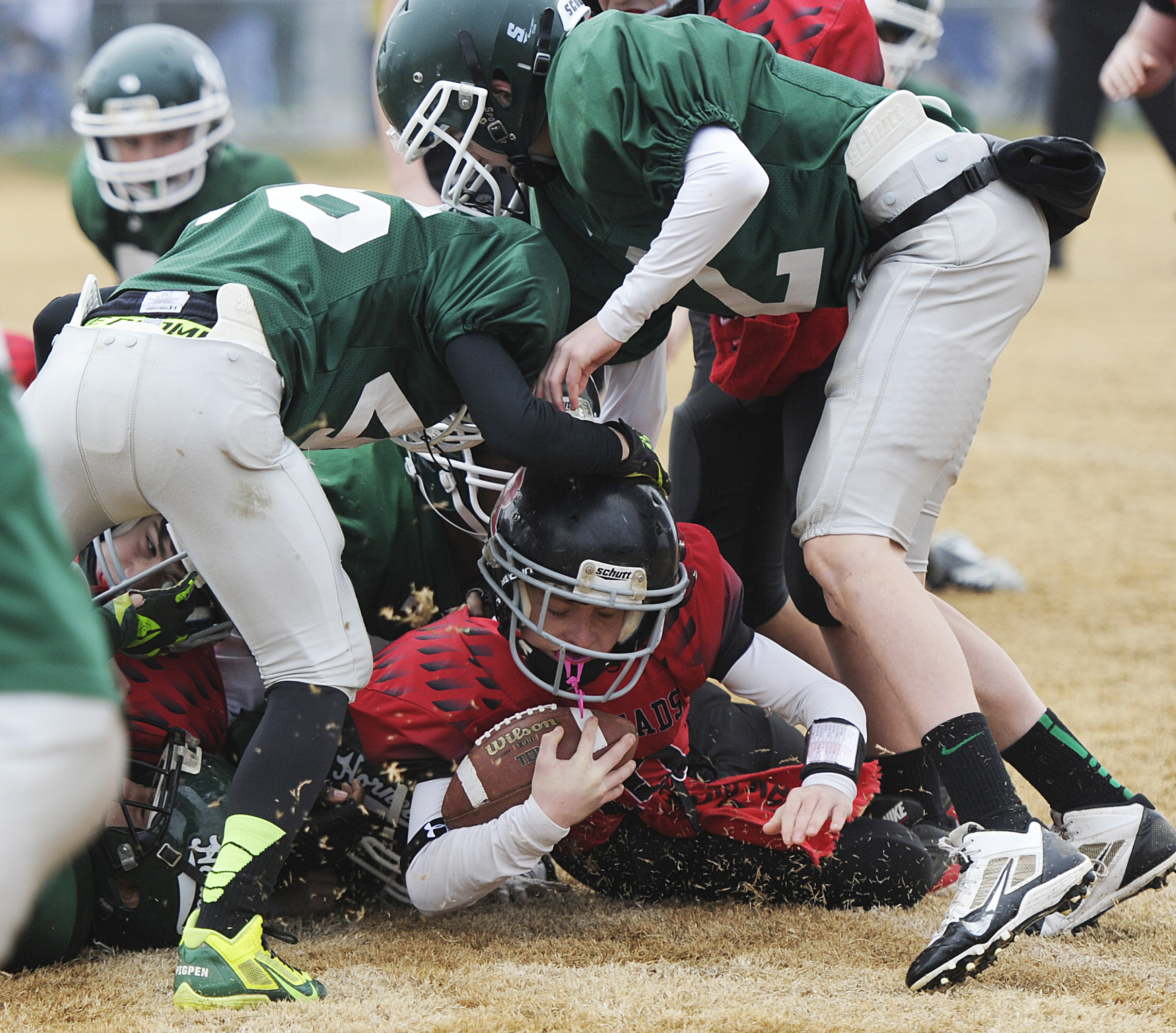Riverheads' Devin Morris is tackled by a group of Wilson players during the seniors division game for the Augusta County Quarterback Club Little League Super Bowl on Saturday, Nov. 16, 2013, in Stuarts Draft.