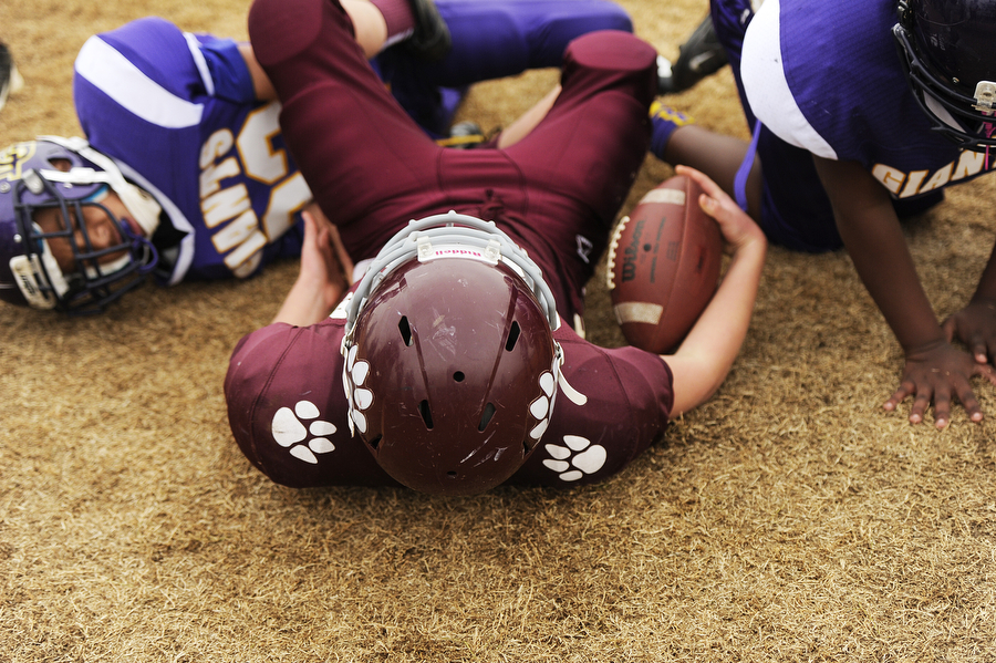 Stuarts Draft's Mark Rodgers gets up after running out of bounds during the Juniors Division game against Waynesboro for the Augusta County Quarterback Club Little League Super Bowl on Saturday, Nov. 16, 2013, in Stuarts Draft.