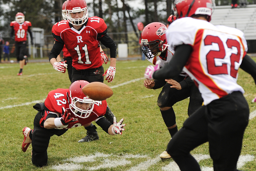 Riverheads' Colt Miller jumps out to retrieve a ball during the first round of Group 2A East playoff football game against Arcadia on Saturday, Nov. 16, 2013, in Greenville.