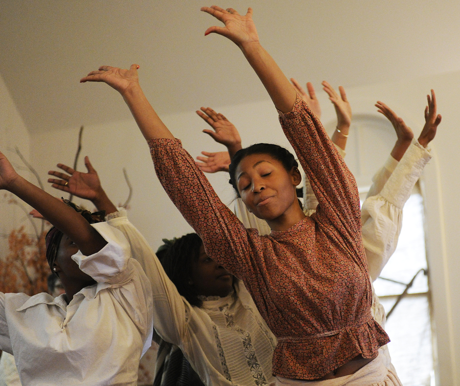 Ciara Dacosta, right, performs a dance with others during a praise house service on Sunday, Nov. 17, 2013, at Allen Chapel AME Church in Staunton. The service, a joint service between Allen Chapel and Christ Our Redeemer AME Church, was a celebration of the traditions of antebellum-era African American churches.