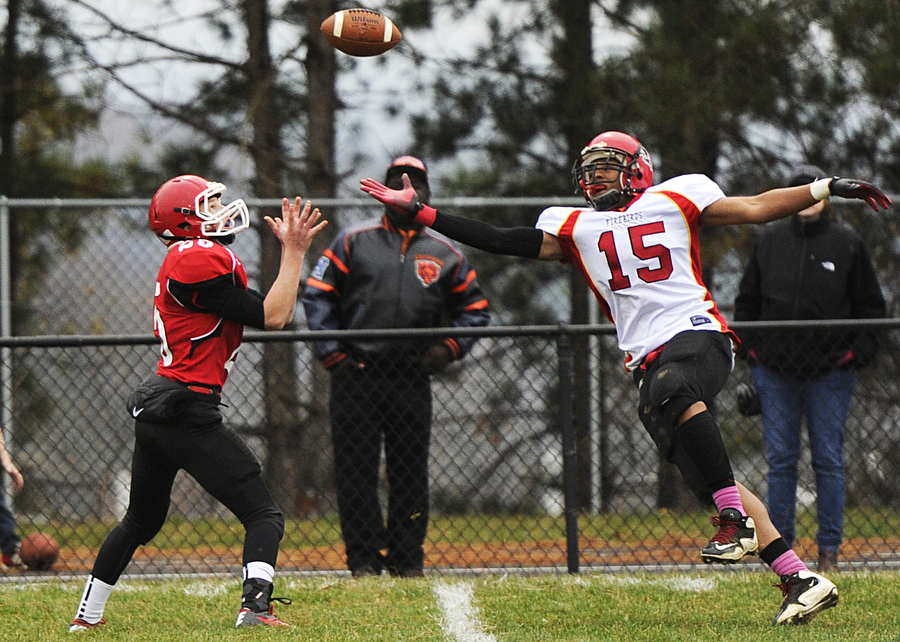 Riverheads' Bret Hostetler reaches out to catch a pass intended for Arcadia's Eric Grinage during the first round of Group 2A East playoff football game on Saturday, Nov. 16, 2013, in Greenville.