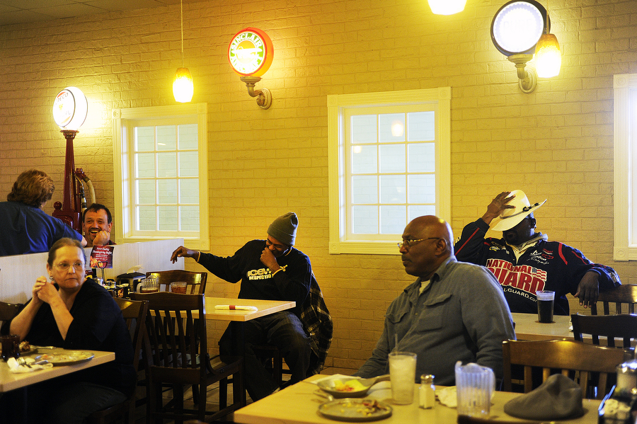 Patrons laugh and watch a football game at the Iron Skillet inside White's Travel Plaza on Thursday, Nov. 28, 2013, in Raphine. The restaurant and truck stop is off I-81 and sees many travelers and truck drivers daily.
