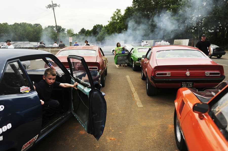 Evan Day, 6, of Waynesboro exits the car while drivers wait to compete in time trials at the Eastside Speedway on Sunday, June 2, 2013, in Dooms. The drag races involved street cars, footbrake, super pro, motorcycles and dragsters.