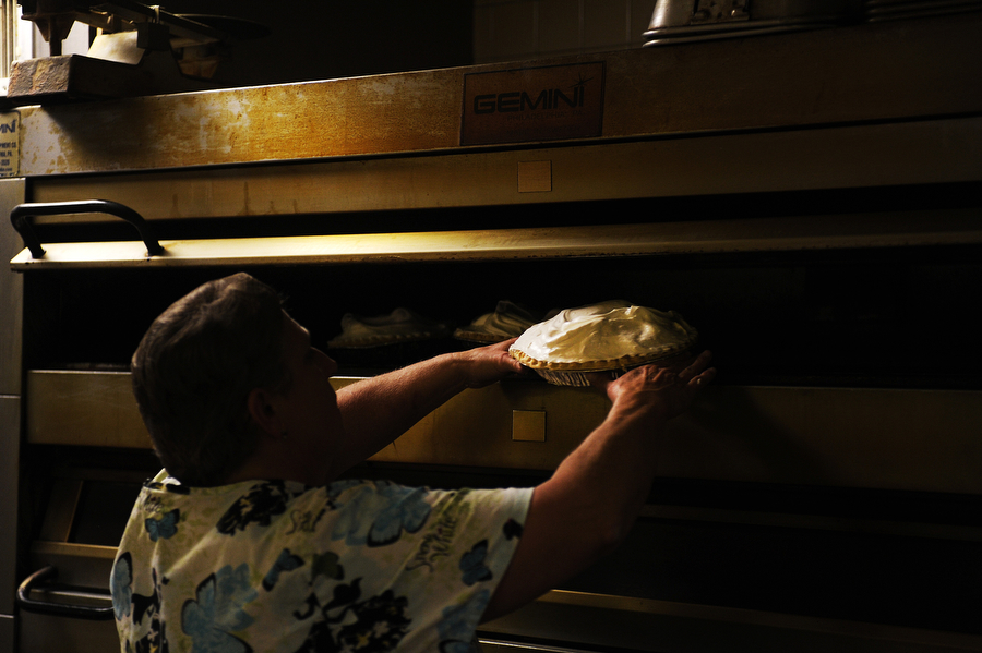 Cynthia Craig added coconut creme pies to the oven in the kitchen at Mrs. Rowes on Tuesday, Nov. 19, 2013, in Staunton.