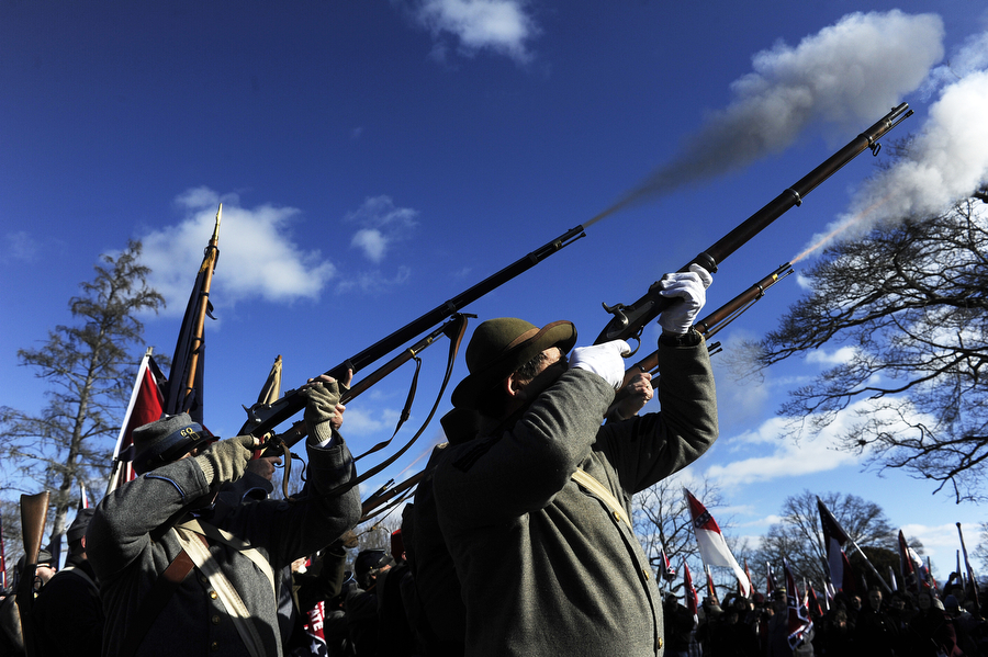 Re-enactors fire of a gun salute during Lee-Jackson Day events at Stonewall Jackson Memorial Cemetery on Saturday, Jan. 18, 2014, in Lexington. The day celebrates the birthdays of Robert E. Lee (Jan. 19) and Stonewall Jackson (Jan. 21).