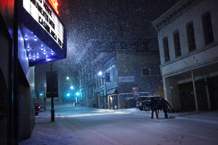 Snow falls in front of the Visulite Cinema on Augusta Street on Feb. 12, 2014, in Staunton.