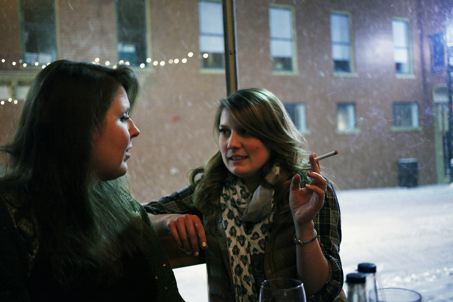 Hannah Scott and Julia Price talk over drinks at the Baja Bean on Wednesday, Feb. 12, 2014, in Staunton.