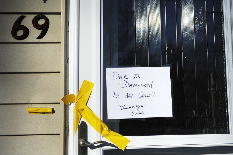 A sign on the door notes that it is broken at 69 Falling Rock Drive on Monday, Jan. 20, 2014, in Stuarts Draft. The landlord of the property recently evicted a tenant and was spending the day cleaning.