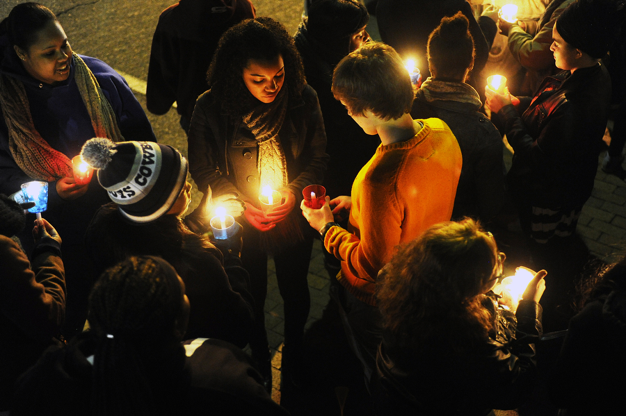 People light candles before the Martin Luther King Jr. Candlelight March on Monday, Jan. 20, 2014, in front of Central United Methodist Church in Staunton. The march, which is followed by a memorial service, has been held for 23 years.