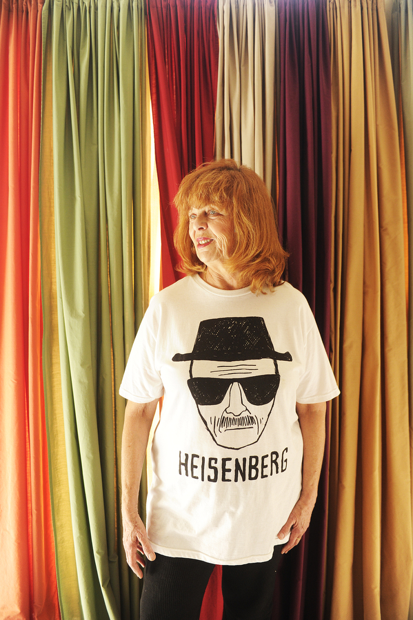 "Bette Amsler, who says her favorite television show of all time is ""Breaking Bad,"" wears her Heisenberg t-shirt in her apartment. Amsler profiles people for The News Leader."
